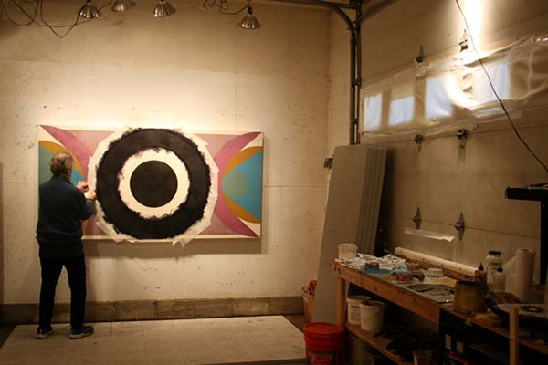 Sandy Sokoloff works on a painting in his studio