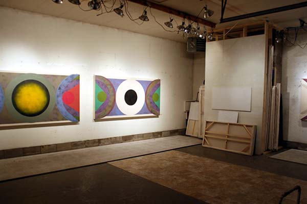 Paintings line the wall of Sokoloff's studio