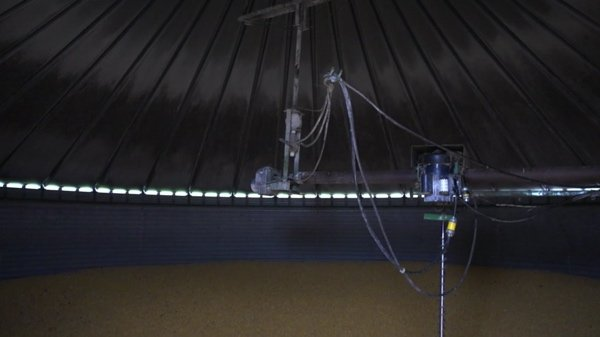 A video still of a camera set up in a large domed area