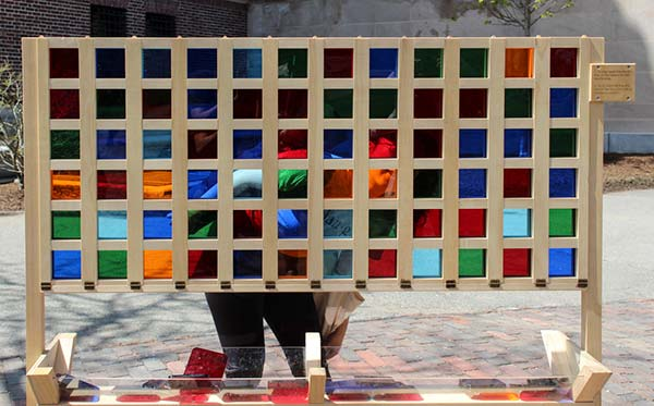 An interactive art installation where bystanders place colored squares into a grid