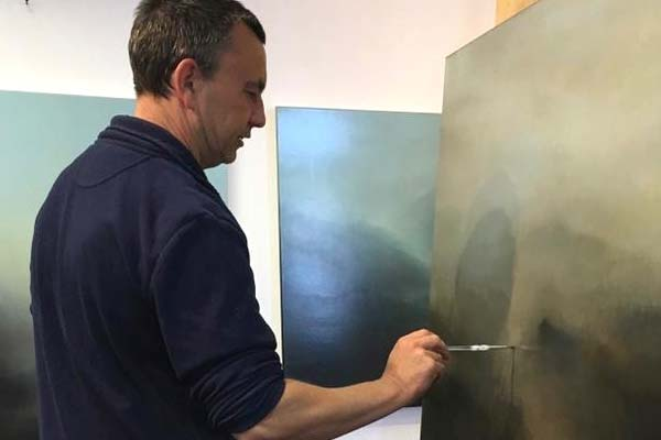 Richard Whadcock working on a painting