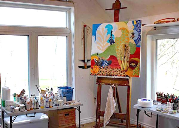 A work of Ferdinands hangs on an easel in the corner of her studio