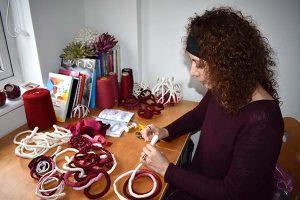 Tara Kennedy works in her studio in the United Kingdom