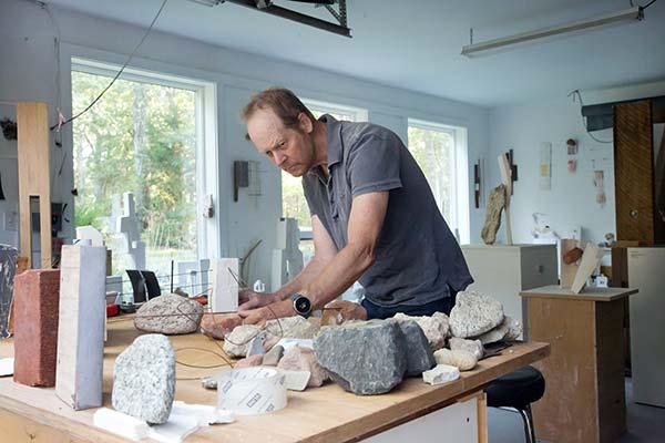 Mark Webber works in his studio in the Hamptons