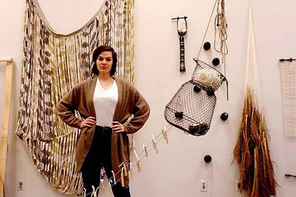 Sophia Ruppert with her fiber sculptures