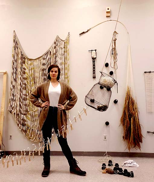 Sophia Ruppert with her fiber sculptures