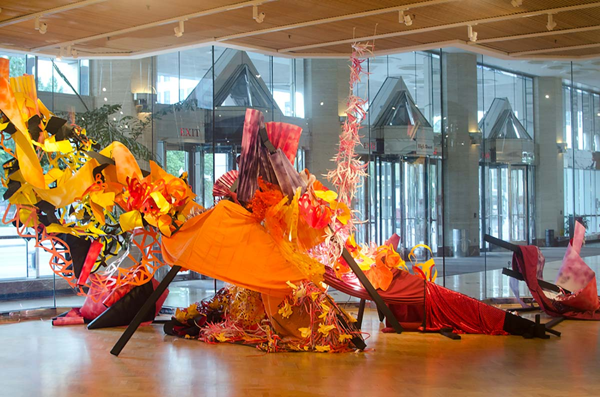 Let's Celebrate (with detail) paper, wood, rope, fabric, wire 10' x 8' x 15' by Emily Moores